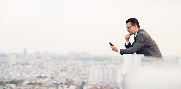 business-man-on-smartphonesss.jpg
